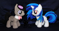 Size: 900x480 | Tagged: safe, artist:wollyshop, octavia melody (mlp), vinyl scratch (mlp), earth pony, equine, fictional species, mammal, pony, unicorn, friendship is magic, my little pony, bowtie, clothes, duo, duo female, female, feral, filly, goggles, horn, irl, looking at each other, photo, plushie, smiling, solo, solo female, tail, watermark